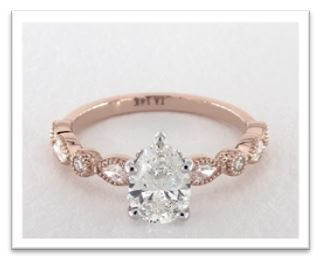 rose gold pear cut engagement ring